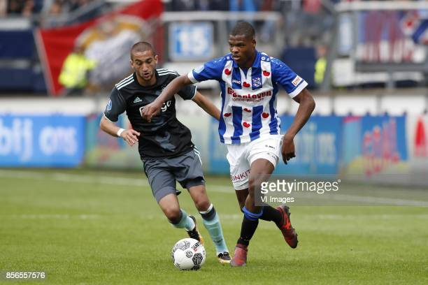 Hakim Ziyech of Ajax Denzel Dumfries of sc Heerenveen during the Dutch Eredivisie match between sc Heerenveen and Ajax Amsterdam at Abe Lenstra...