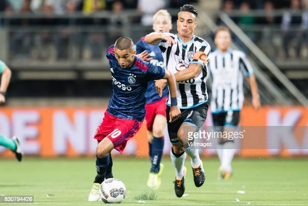 Hakim Ziyech of Ajax Joey Pelupessy of Heracles Almelo during the Dutch Eredivisie match between Heracles Almelo and Ajax Amsterdam at Polman stadium...
