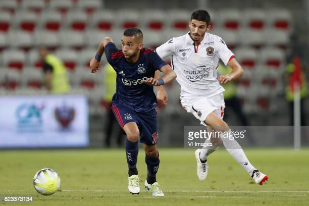 Hakim Ziyech of Ajax Pierre LeesMelou of OCG Nice during the UEFA Champions League third round qualifying first leg match between OGC Nice and Ajax...
