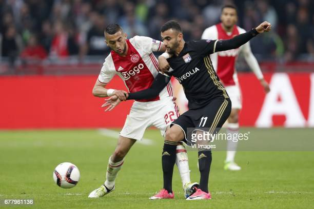 Hakim Ziyech of Ajax Rachid Ghezzal of Olympique Lyonnaisduring the UEFA Europa League semi final match between Ajax Amsterdam and Olympique Lyonnais...