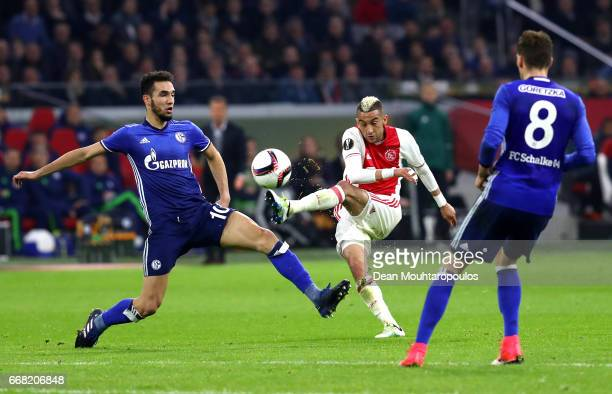 Hakim Ziyech of Ajax shoots on goal during the UEFA Europa League quarter final first leg match between Ajax Amsterdam and FC Schalke 04 at Amsterdam...