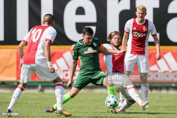 Hakim Ziyech of Ajax Zlatko Junuzovic of SV Werder Bremen Lasse Schone of Ajax Matthijs de Ligt of Ajax during the friendly match between Ajax...