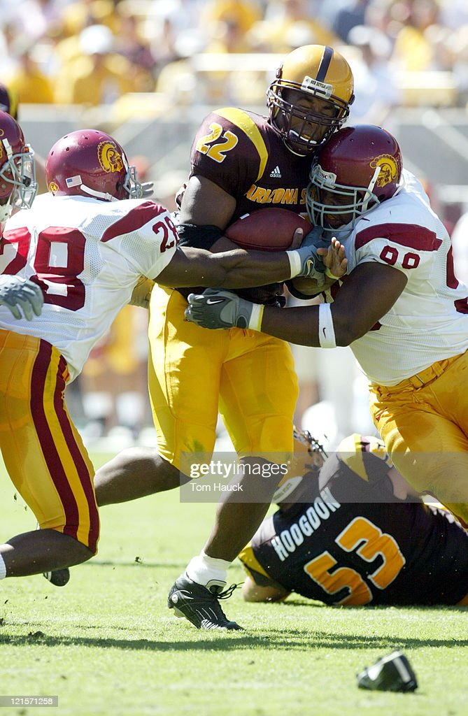Hakimi Hill of the Arizona State Sun Devils is tackled by Mike Patterson of the USC Trojans at Sundevil Stadium in TempeAZ USC won 3717
