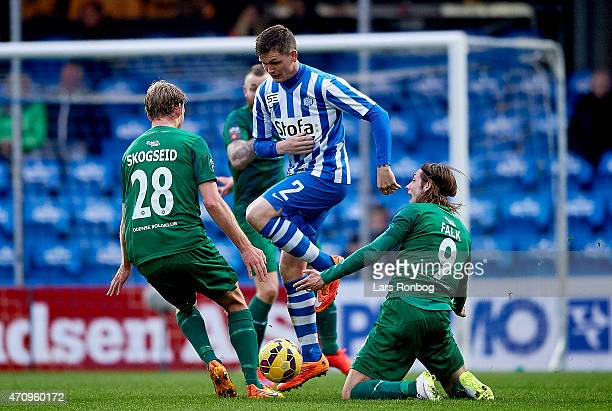 Hakon Skogseid of OB Odense Michael Jakobsen of Esbjerg fB and Rasmus Falk of OB Odense compete for the ball during the Danish Alka Superliga match...