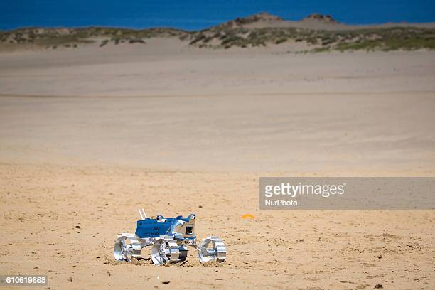Hakuto's rover PFM3 preflight model is seen being tested by team ispace Tohoku University researchers and students in Tottori Sand Dunes Tottori...