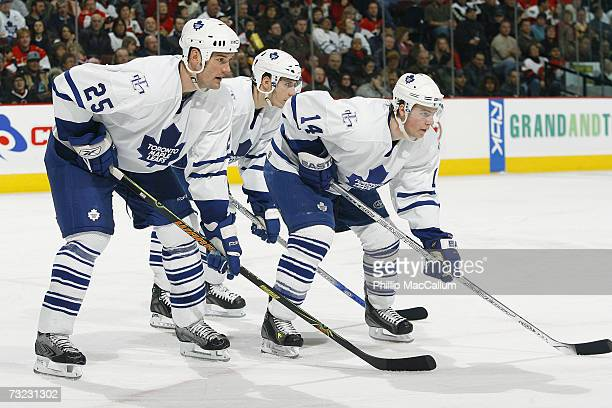Hal Gill Alex Steen and Matt Stajan of the Toronto Maple Leafs line up in position prior to a defensive zone faceoff against the Ottawa Senators...