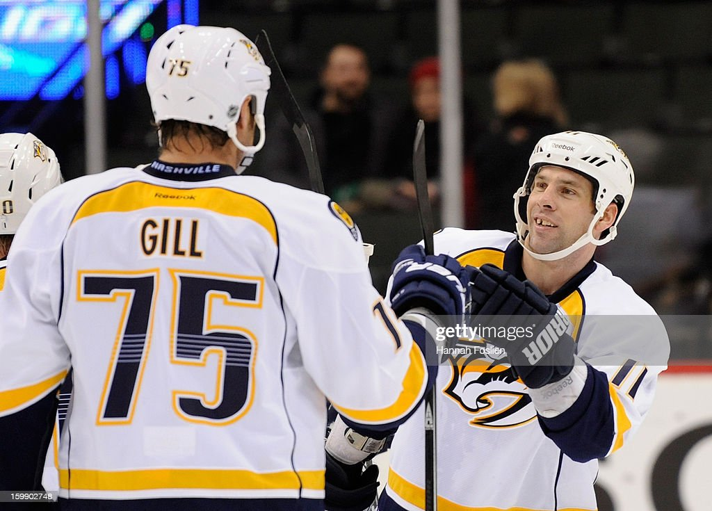 Hal Gill #75 and David Legwand #11 of the Nashville Predators celebrate a win against the Minnesota Wild on January 22, 2013 at Xcel Energy Center in St Paul, Minnesota. The Predators defeated the Wild 3-1.