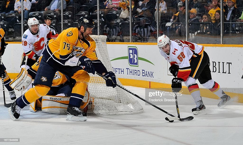 <a gi-track='captionPersonalityLinkClicked' href=/galleries/search?phrase=Hal+Gill&family=editorial&specificpeople=209158 ng-click='$event.stopPropagation()'>Hal Gill</a> #75 of the Nashville Predators skates against <a gi-track='captionPersonalityLinkClicked' href=/galleries/search?phrase=Ben+Hanowski&family=editorial&specificpeople=5894592 ng-click='$event.stopPropagation()'>Ben Hanowski</a> #58 of the Calgary Flames at the Bridgestone Arena on April 23, 2013 in Nashville, Tennessee.