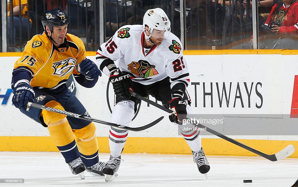 <a gi-track='captionPersonalityLinkClicked' href=/galleries/search?phrase=Hal+Gill&family=editorial&specificpeople=209158 ng-click='$event.stopPropagation()'>Hal Gill</a> #75 of the Nashville Predators skates against <a gi-track='captionPersonalityLinkClicked' href=/galleries/search?phrase=Viktor+Stalberg&family=editorial&specificpeople=5802237 ng-click='$event.stopPropagation()'>Viktor Stalberg</a> #25 of the Chicago Blackhawks during an NHL game at the Bridgestone Arena on April 6, 2013 in Nashville, Tennessee.