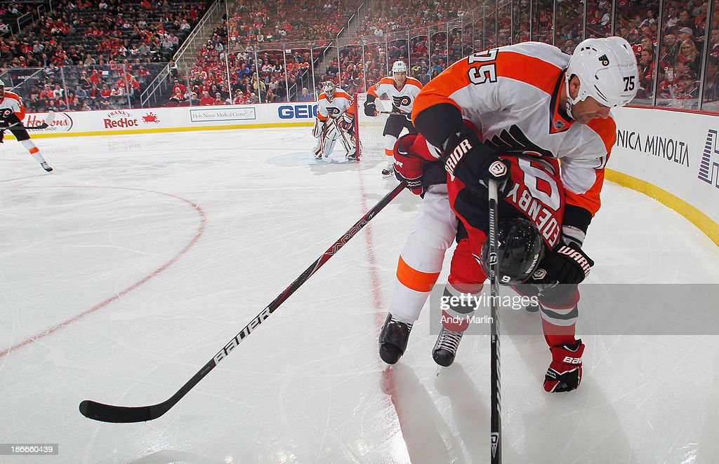 <a gi-track='captionPersonalityLinkClicked' href=/galleries/search?phrase=Hal+Gill&family=editorial&specificpeople=209158 ng-click='$event.stopPropagation()'>Hal Gill</a> #75 of the Philadelphia Flyers and <a gi-track='captionPersonalityLinkClicked' href=/galleries/search?phrase=Mattias+Tedenby&family=editorial&specificpeople=5370913 ng-click='$event.stopPropagation()'>Mattias Tedenby</a> #9 of the New Jersey Devils come together in the corner during the game at the Prudential Center on November 2, 2013 in Newark, New Jersey.