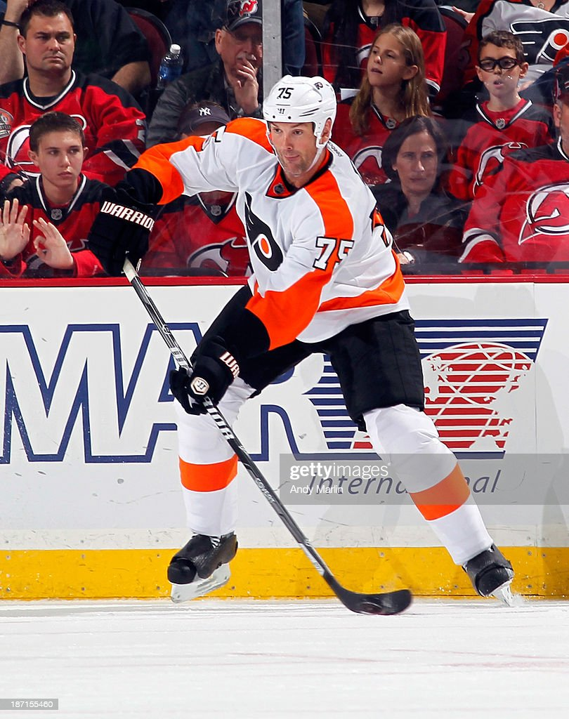 Hal Gill #75 of the Philadelphia Flyers controls the puck during the game against the New Jersey Devils at the Prudential Center on November 2, 2013 in Newark, New Jersey.