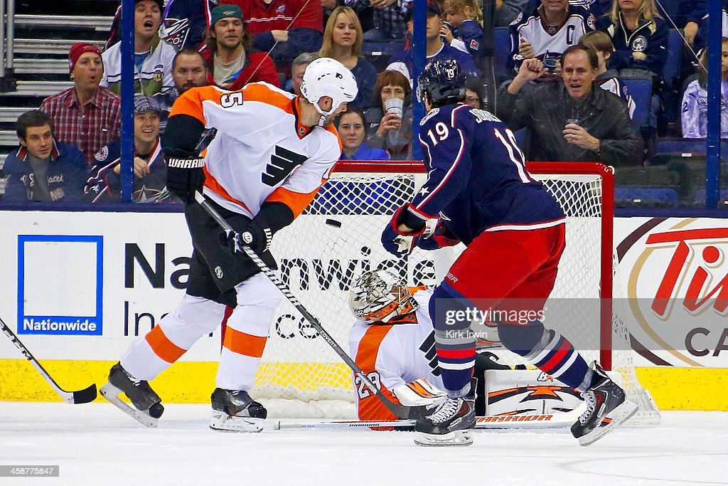 <a gi-track='captionPersonalityLinkClicked' href=/galleries/search?phrase=Hal+Gill&family=editorial&specificpeople=209158 ng-click='$event.stopPropagation()'>Hal Gill</a> #75 of the Philadelphia Flyers watches as <a gi-track='captionPersonalityLinkClicked' href=/galleries/search?phrase=Ryan+Johansen&family=editorial&specificpeople=6698841 ng-click='$event.stopPropagation()'>Ryan Johansen</a> #19 of the Columbus Blue Jackets beats <a gi-track='captionPersonalityLinkClicked' href=/galleries/search?phrase=Ray+Emery&family=editorial&specificpeople=218109 ng-click='$event.stopPropagation()'>Ray Emery</a> #29 of the Philadelphia Flyers for a goal during the first period on December 21, 2013 at Nationwide Arena in Columbus, Ohio.