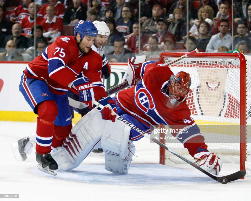 Hal Gill picks up the loose puck to the side of teammate Jaroslav Halak of the Montreal Canadiens in Game Six of the Eastern Conference Quarterfinals...
