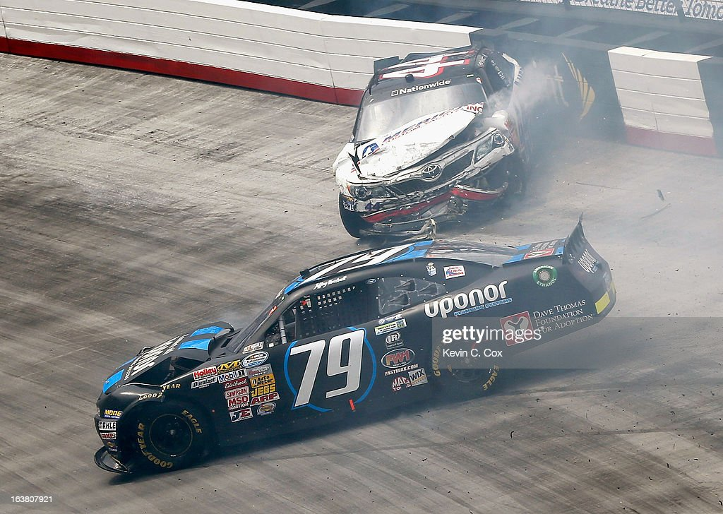 Hal Martin, driver of the #44 American Custom Yachts Toyota, hits the wall as Jeffrey Earnhardt, driver of the #79 Uponor Ford, spins out during the NASCAR Nationwide Series Jeff Foxworthy's Grit Chips 300 at Bristol Motor Speedway on March 16, 2013 in Bristol, Tennessee.