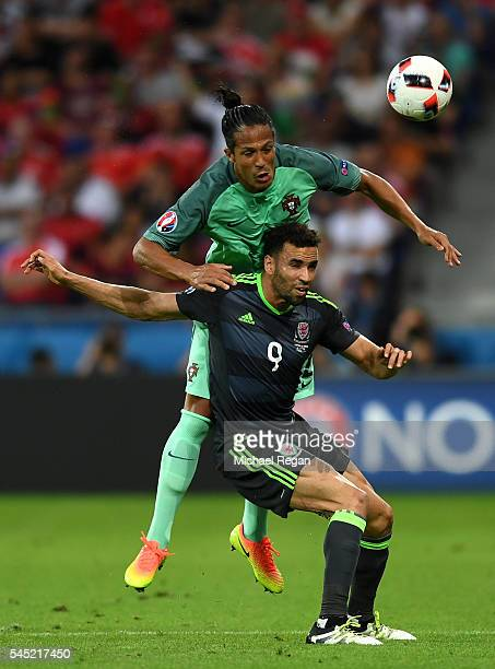 Hal RobsonKanu of Wales battles for the ball with Bruno Alves of Portugal during the UEFA EURO 2016 semi final match between Portugal and Wales at...