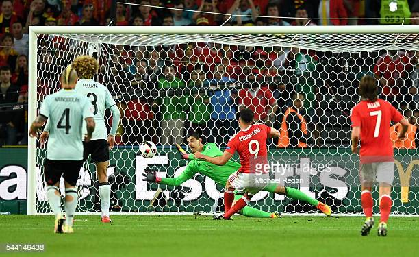 Hal RobsonKanu of Wales scores his team's second goal past Thibaut Courtois of Belgium during the UEFA EURO 2016 quarter final match between Wales...
