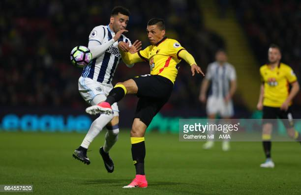 Hal RobsonKanu of West Bromwich Albion and Craig Cathcart of Watford during the Premier League match between Watford and West Bromwich Albion at...