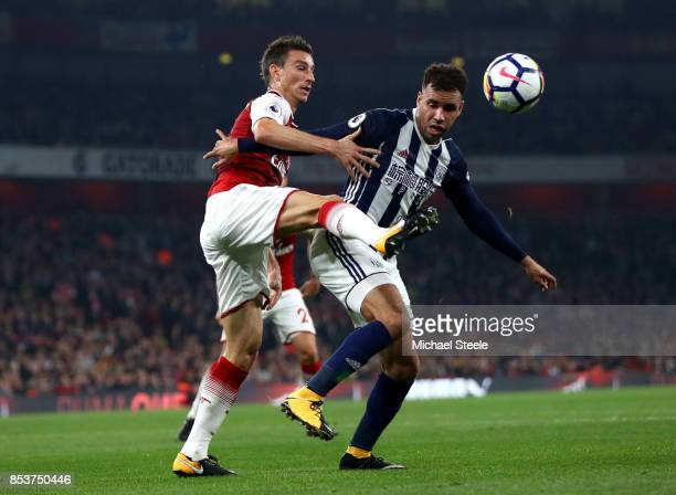 Hal RobsonKanu of West Bromwich Albion and Laurent Koscielny of Arsenal battle for the ball during the Premier League match between Arsenal and West...