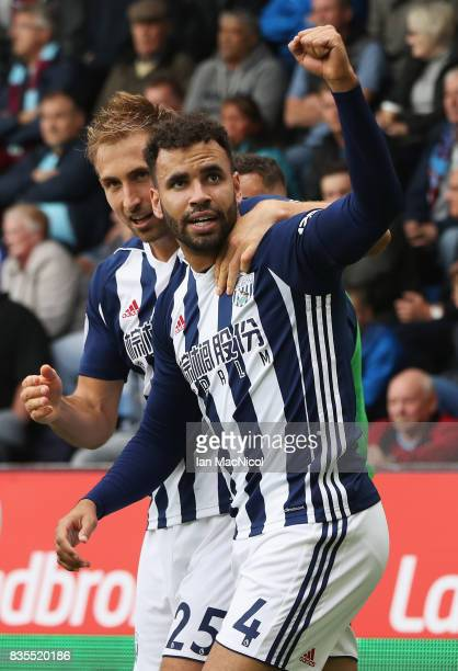 Hal RobsonKanu of West Bromwich Albion celebrates scoring his sides first goal with Craig Dawson of West Bromwich Albion during the Premier League...