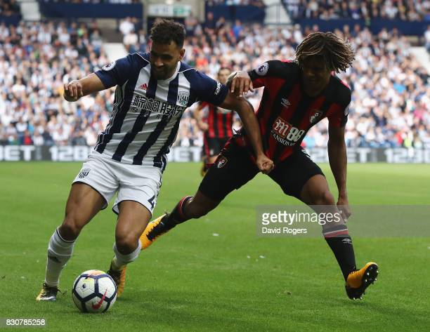 Hal RobsonKanu of West Bromwich Albion is challenged by Nathan Ake during the Premier League match between West Bromwich Albion and AFC Bournemouth...