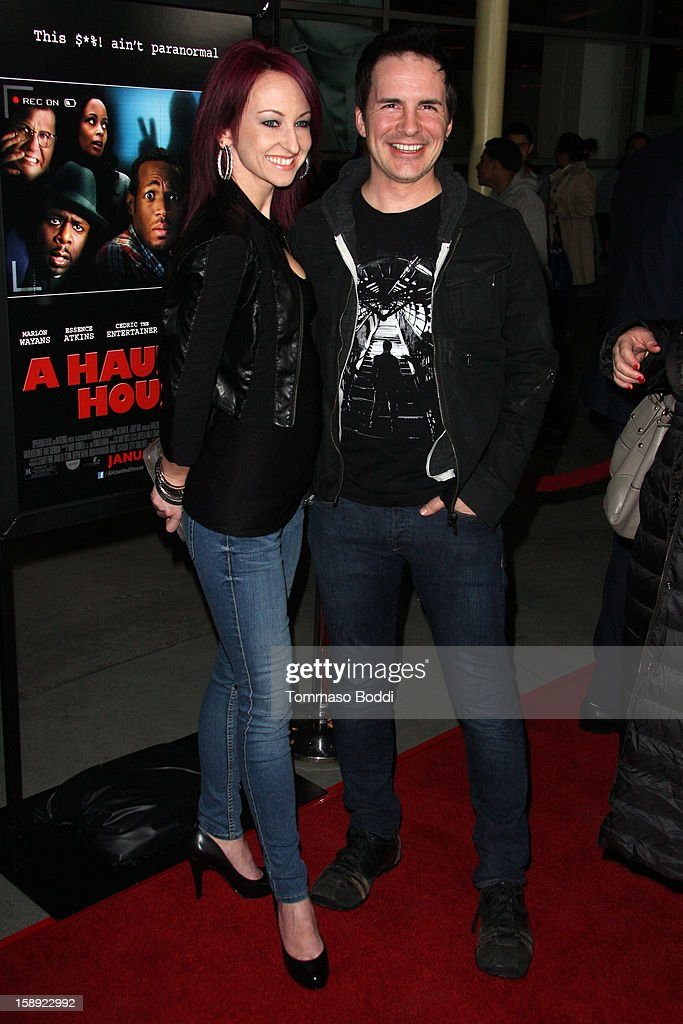 Hal Sparks (R) and guest attend the 'A Haunted House' Los Angeles premiere held at the ArcLight Hollywood on January 3, 2013 in Hollywood, California.