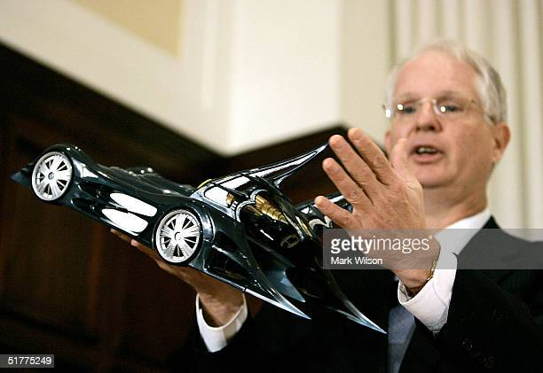 Hal Stratton Chairman of the Consumer Product Safety Commission shows a recalled 'Batmobile' made by Mattel that has sharp points that may cause a...