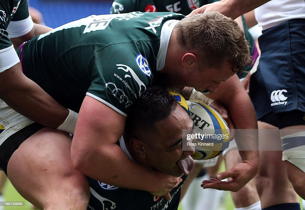 Halani Aulika of London Irishis congratulated after he goes over for atry during the Aviva Premiership match between London Irish and Sales Sharks at the Madejski Stadium on March 31, 2013 in Reading, England.
