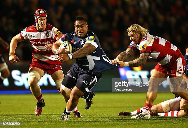 Halani Aulika of Sale Sharks is tackled by Richard Hibbard of Gloucester Rugby during the Aviva Premiership match between Sale Sharks and Gloucester...