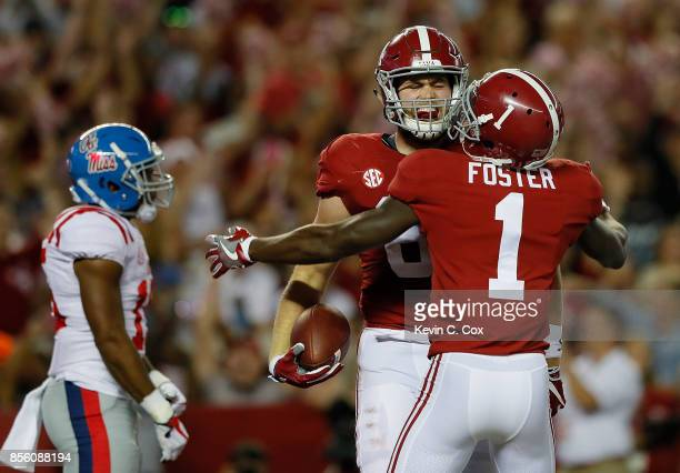 Hale Hentges of the Alabama Crimson Tide reacts after pulling in a touchdown reception against the Mississippi Rebels at BryantDenny Stadium on...