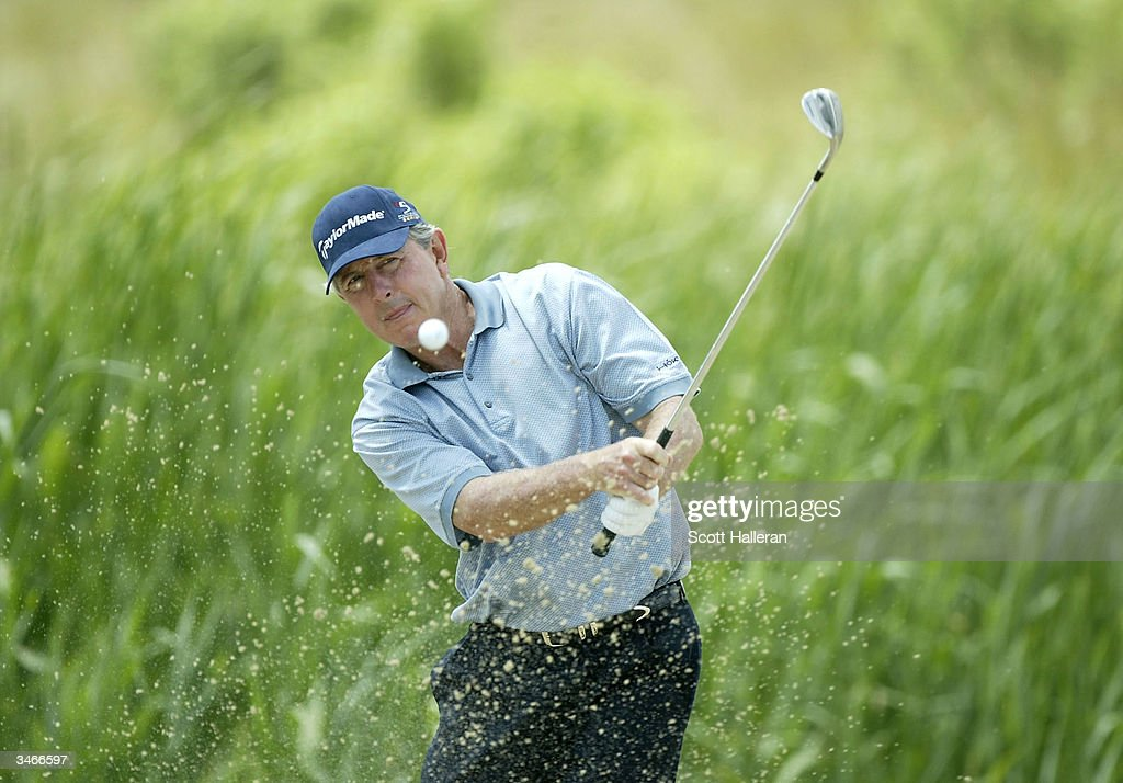 Hale Irwin plays a bunker shot on the eighth hole during the final round of the Liberty Mutual Legends of Golf at the Club at Savannah Harbor on...
