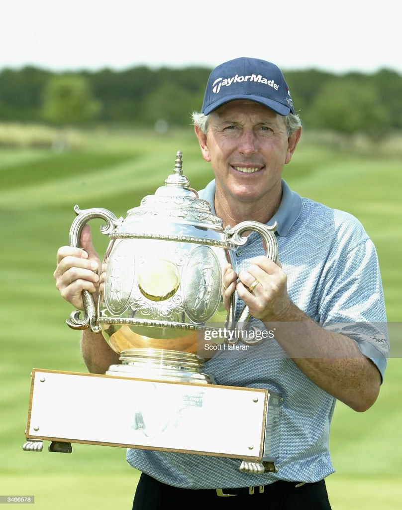 Hale Irwin poses with the trophy after a onestroke victory at the Liberty Mutual Legends of Golf at the Club at Savannah Harbor on April 25 2004 in...