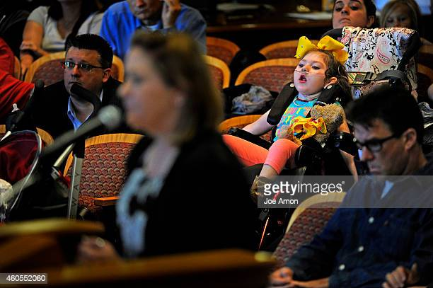 Haleigh Cox waits as her mother Janéa testifies at the state Capitol in support of caregiver Jason Cranford and Haleigh's Hope a highcannabidiol oil...