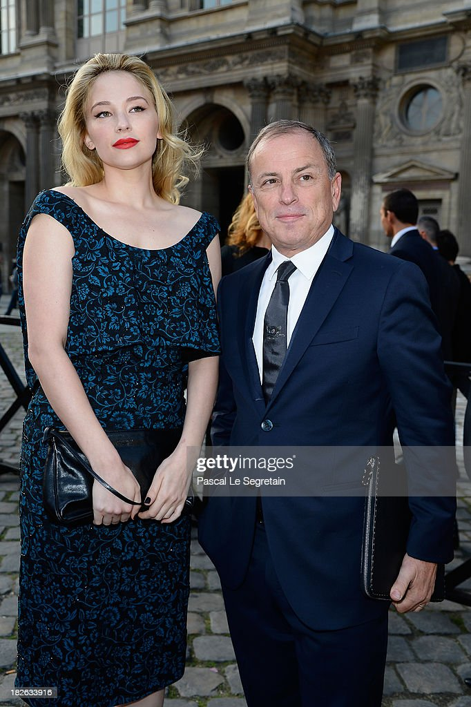 Haley Bennett and Michael Burke attend the Louis Vuitton show as part of the Paris Fashion Week Womenswear Spring/Summer 2014 at Le Carre du Louvre on October 2, 2013 in Paris, France.
