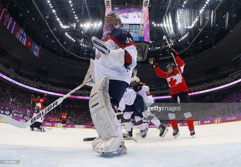 Haley Irwin #21 of Canada celebrates after Jessie Vetter #31 of the United States gave up a goal in the third period during the Ice Hockey Women's Gold Medal Game on day 13 of the Sochi 2014 Winter Olympics at Bolshoy Ice Dome on February 20, 2014 in Sochi, Russia.