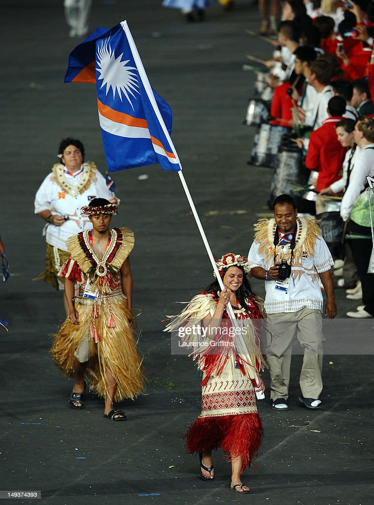 Haley Nemra of the Marshall Islands Olympic athletics team carries her country's flag during the Opening Ceremony of the London 2012 Olympic Games at the Olympic Stadium on July 27, 2012 in London, England.