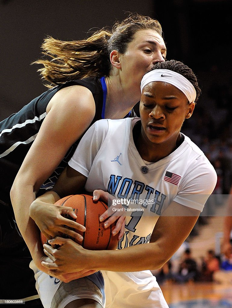 Haley Peters #33 of the Duke Blue Devils battles for a rebound with Brittany Rountree #11 of the North Carolina Tar Heels during play at Carmichael Arena on February 3, 2013 in Chapel Hill, North Carolina.