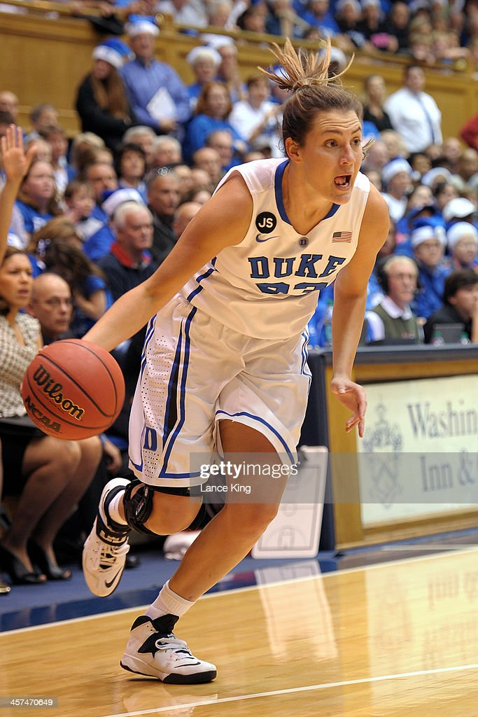 Haley Peters #33 of the Duke Blue Devils drives against the Connecticut Huskies at Cameron Indoor Stadium on December 17, 2013 in Durham, North Carolina. Connecticut defeated Duke 83-61.
