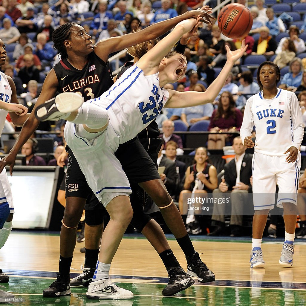 Haley Peters #33 of the Duke Blue Devils fights for a rebound against Natasha Howard #33 and Chelsea Davis #34 of the Florida State Seminoles during the semifinals of the 2013 Women's ACC Tournament at the Greensboro Coliseum on March 9, 2013 in Greensboro, North Carolina.