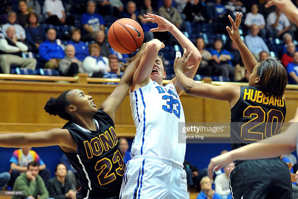 Haley Peters #33 of the Duke Blue Devils is fouled during a shot attempt by Kadesia Johnson #23 of the Iona Gaels at Cameron Indoor Stadium on November 18, 2012 in Durham, North Carolina. Duke defeated Iona 100-31.