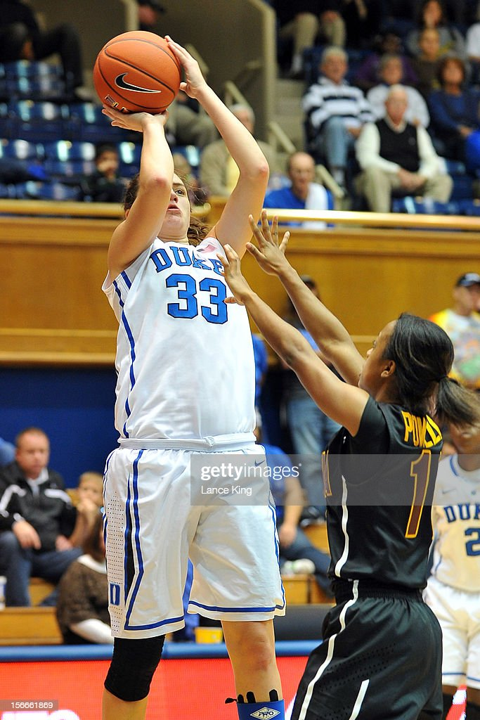 Haley Peters #33 of the Duke Blue Devils puts up a shot against Aleesha Powell #11 of the Iona Gaels at Cameron Indoor Stadium on November 18, 2012 in Durham, North Carolina. Duke defeated Iona 100-31.