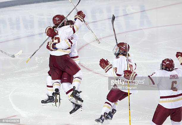 Haley Skarupa of the Boston College Eagles celebrates her overtime winning goal against the Clarkson Golden Knights with her teammates Alex Carpenter...