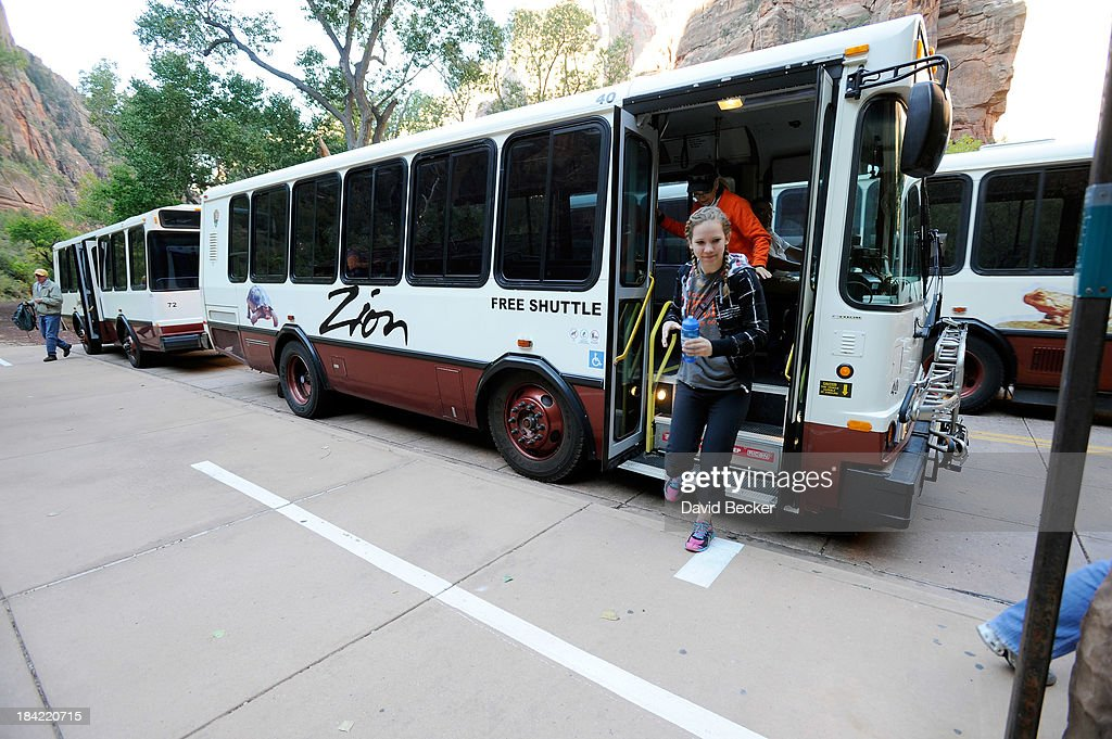 Haley Van de Merwen of Ohio, exits on the free shuttle buses that ferry visitors along the Zion Canyon Scenic Drive inside the now open Zion National Park on October 12, 2013 in Springdale, Utah. The Obama administration said it would allow states to use their own money to reopen some national parks after a handful of governors made the request. Utah Gov. Gary Herbert said he reached an agreement to pay $166,572 a day to the Interior Department to open eight national sites in Utah.