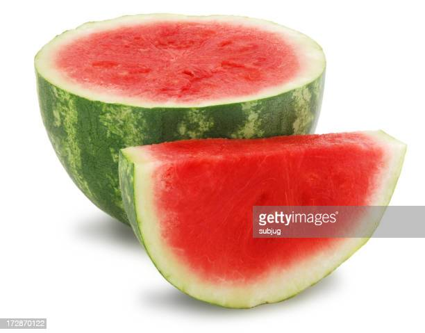 Half a watermelon with a slice of watermelon