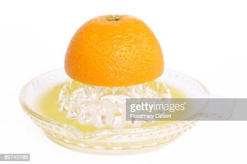 Half an orange being juiced.