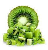 Half green fuzzy kiwifruit and diced isolated over white