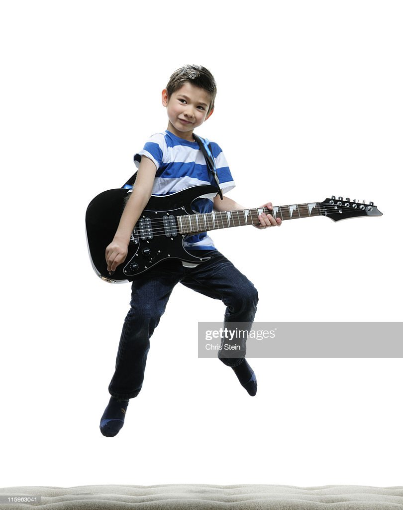 Half Asian Boy rocking out on an electric guitar : Stock Photo