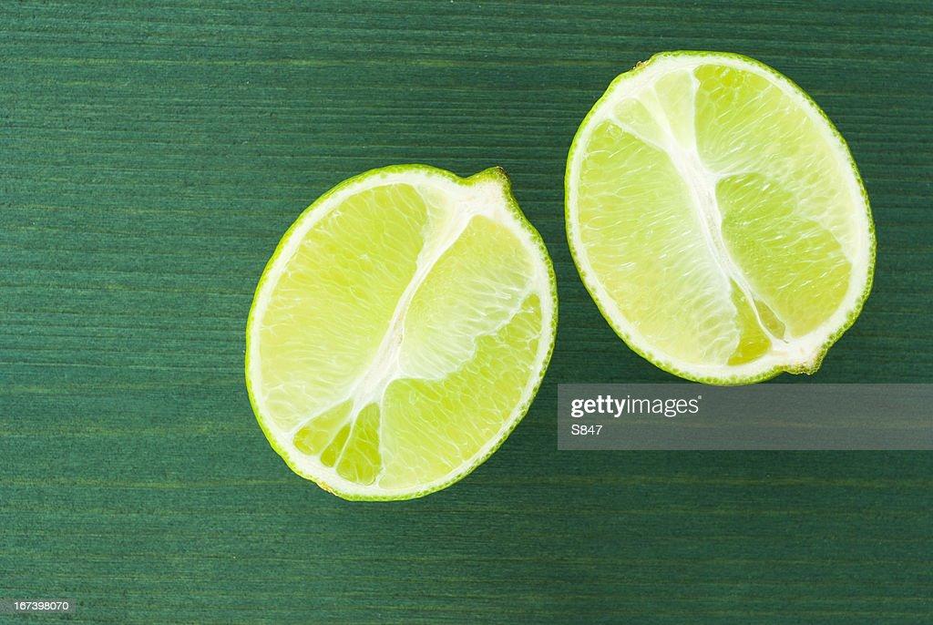 Half cut limes : Stock Photo