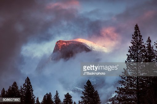 Half Dome Peaking Through during a Winter Storm : Stock Photo