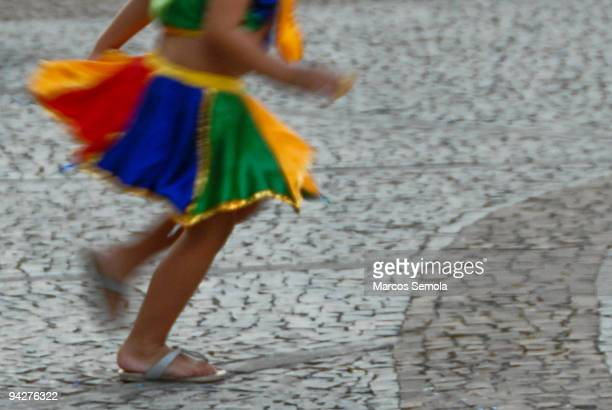 Half down of a child wearing a colourful Brazilian