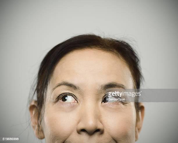 Half face portrait of a happy senior japanese woman.